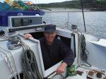 John in his boat